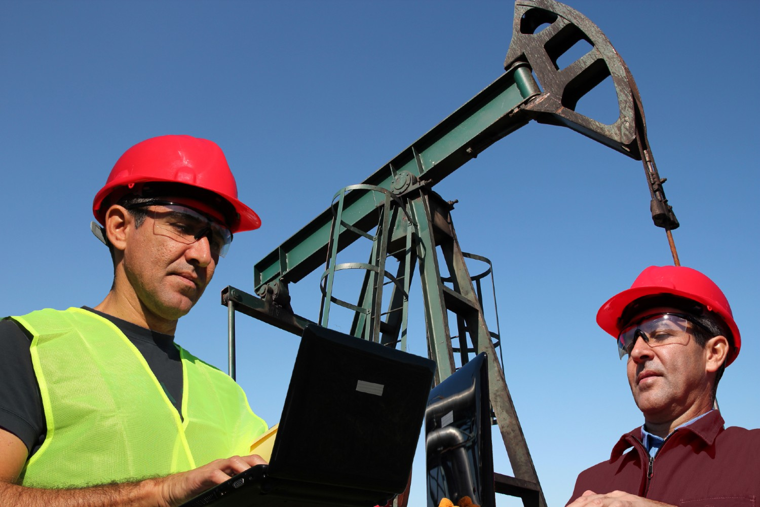 Oil Field Two People Laptops